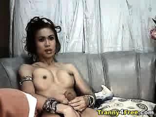 Tranny em g string masturbating