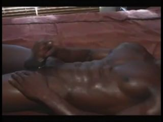 Muscled african hunk jerks off e cums
